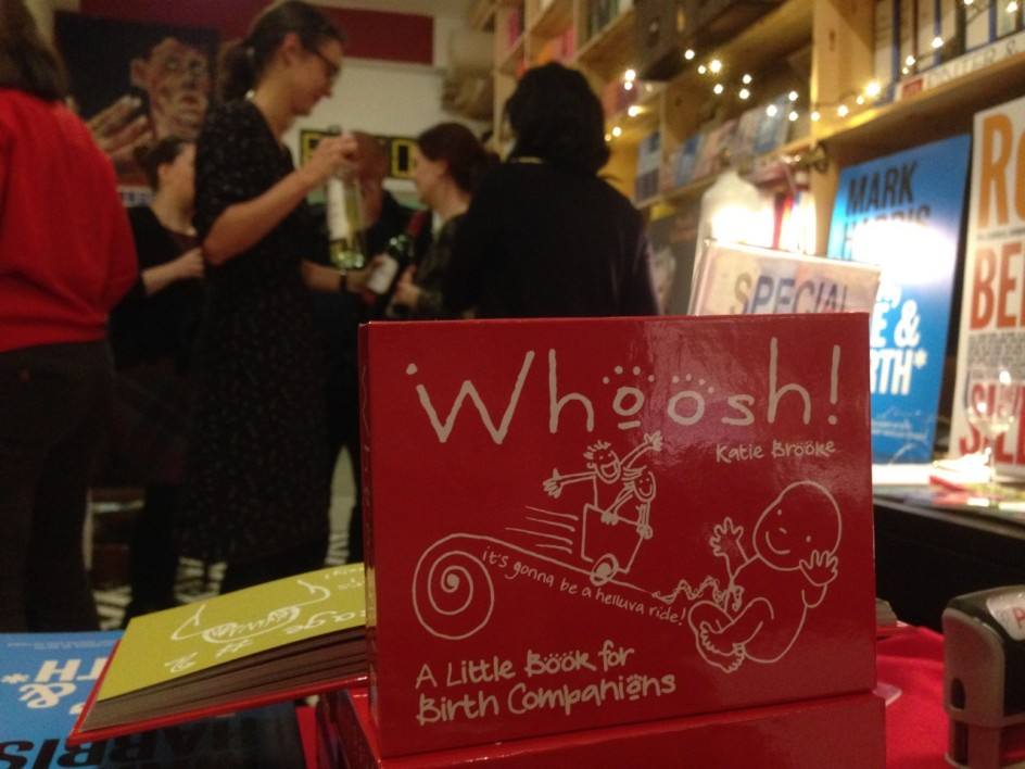 Image of book and launch party in background