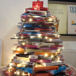 Photograph of a book pile with fairy lights