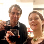 Photograph of Katie Brooke and Martin Wagner holding glasses of wine